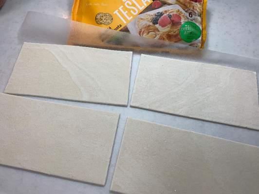 オーブンシート並べた業務スーパーのパイシート