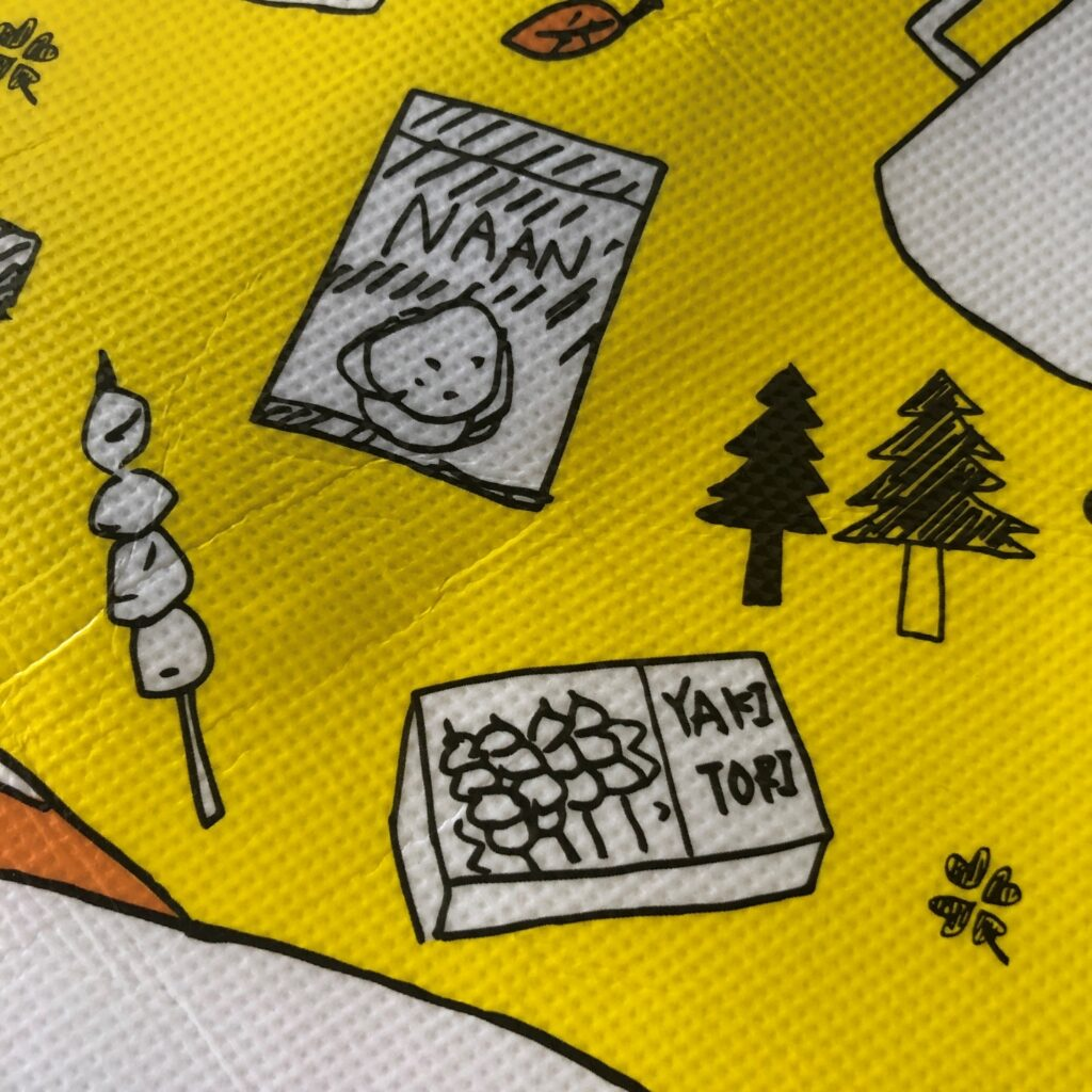 業務スーパーの黄色のエコバッグに描かれてるナンと焼き鳥のイラスト